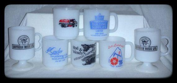 Milk Glass Advertising Mugs.