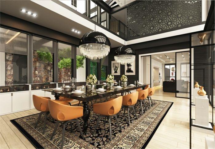 muebles de salon modernos, piso duplex xon comedor grande, mesa de mármol con sillas color ocre y lámparas modernas