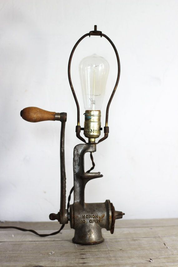 an old meat grinder has been converted into a super neat tabletop lamp. love how the handle moves freely, so you can display it in different ways. add your own Edison bulb for the best look