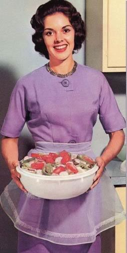 Vintage homemaker showing off a Tupperware container full of salad. #vintage #1950s #1960s #kitchen #Tupperware