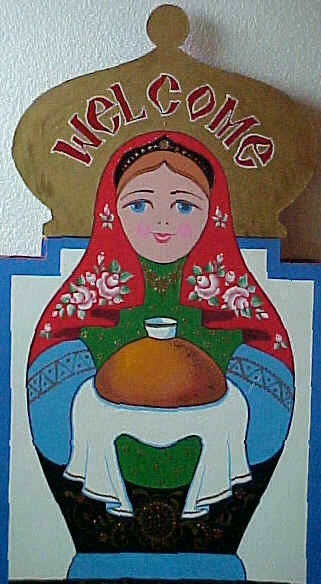Matryoshka (Russian nesting doll) greets  guests with traditional bread and salt.