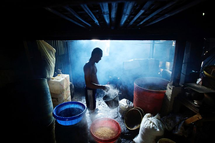 SOY STAPLE: A worker drained and rinsed boiled soy beans at a small tempeh factory in Jakarta, Indonesia,  on July 12, 2013. Tempeh is an Indonesian staple made from fermented soy beans | © Ed Wray | Getty Images