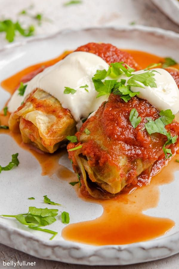 This Stuffed Cabbage Rolls Recipe Is Tender Cabbage Leaves Filled With Lean Ground Beef And Rice And Cabbage Rolls Cabbage Rolls Recipe Homemade Tomato Sauce