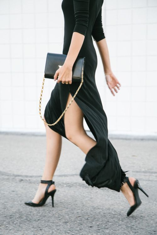 Long elegant black dress and pointy toed ankle strap heels make for a classy look
