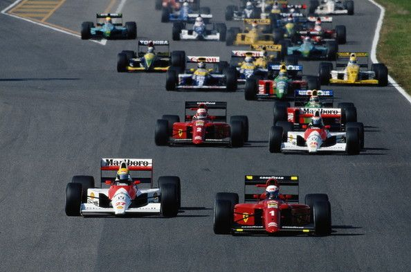 Ayrton Senna driving the Marlboro McLaren-Honda MP4/5 and Alain Prost in the Scuderia Ferrari 641 lead the field at the start of the Japanese Grand Prix on 21 October 1990 at the Suzuka Circuit in Suzuka, Japan. The Japanese Grand Prix decided the 1990 Drivers Championship in Sennas favour after crashing controversially into Prost at the first corner put them both off the track.