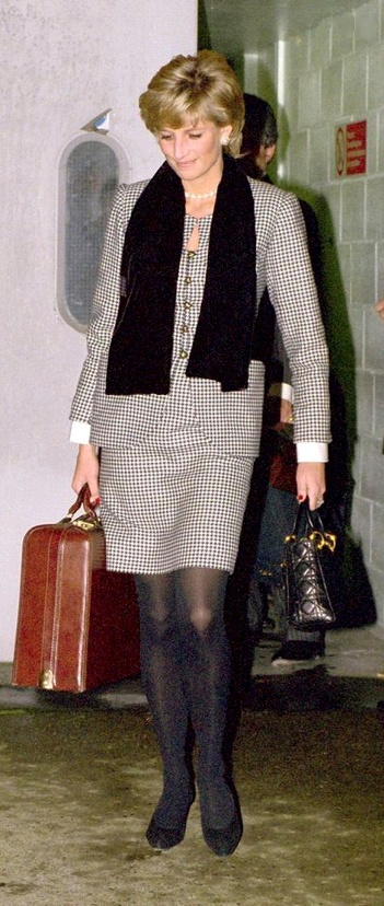 Black & white check suit with black opaques & heels. Black scarf