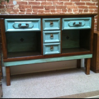 Dresser refurbished into a beautiful side table for your dining room or livingroom. Cubbies to display folded tablecloths. Set on legs for look and easy use. $400.00