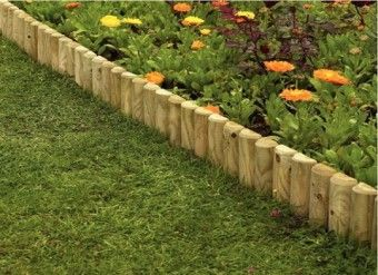 Edge your garden borders with some log rolls which will fade over time to look very natural.  #garden #border #edging