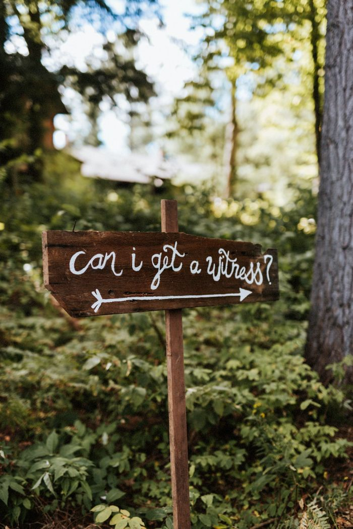 Rustic DIY wedding ceremony sign | Image by Laura Rowe Photography and Kayla Rocca Photography