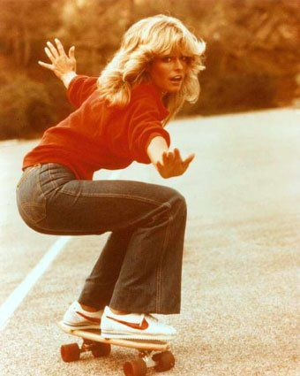 Farrah hair flicks, skateboards and flares. Iconic 70s imagery.