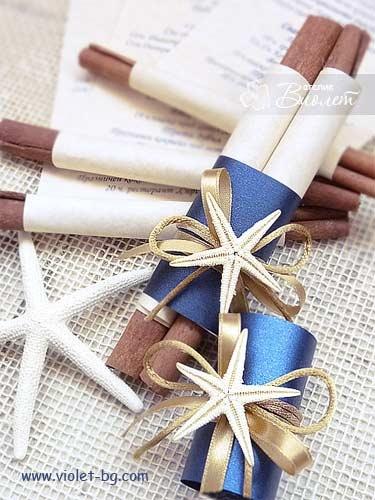 Sea themed wedding invitation scroll with starfish amd cinnamon sticks from www.violet-bg.com