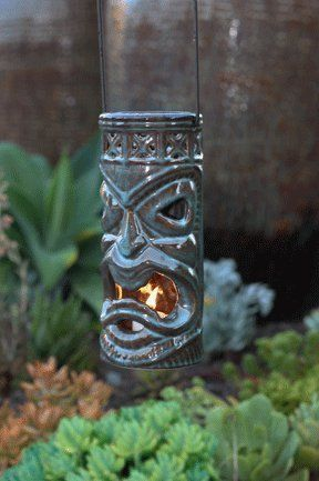 Tiki- Hanging Lantern, Kona by HabitudesTM. Save 25 Off!. $14.95. Attached Metal Hanger. Each meticulessly sculpted and slip cast. These Tikis are an exclusive HabitudesTM design.. Hand finished and fired with reactive glazes. Ridding the World of Bad design one creation at a time is no easy task.  In creating our Pottery Couture line, we endeavor to create fantastic design with a focus on Utility.