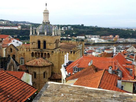 Looking out over Sé Velha, Coimbra's old cathedral, with the Mondego river in the background. This is the view from the terrace of Museu Nacional Machado de Castro in Coimbra.