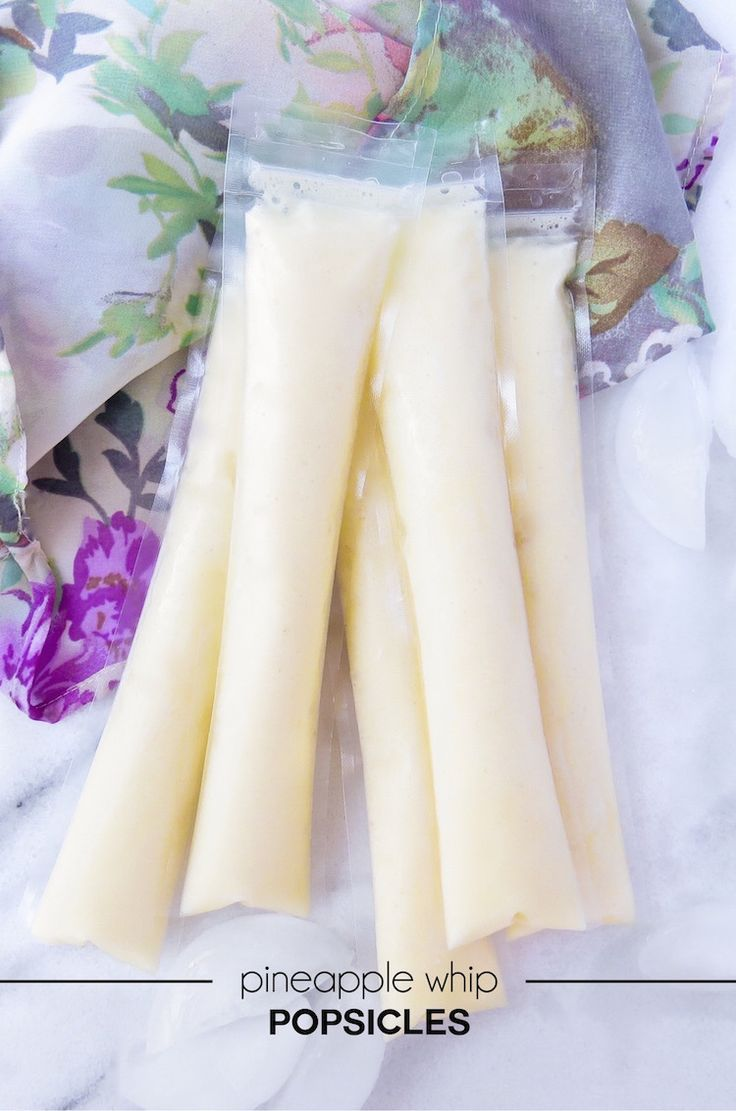 A copycat recipe of Disneyland's dole whip ice cream turned into pineapple whip popsicles! An easy DIY popsicle treat or snack idea.