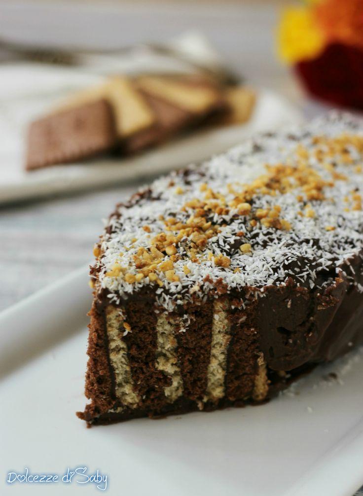 La mattonella al cioccolato zebrata é un dolce velocissimo e scenografico che non va in forno. Ricetta con video da fare anche con i bambini.