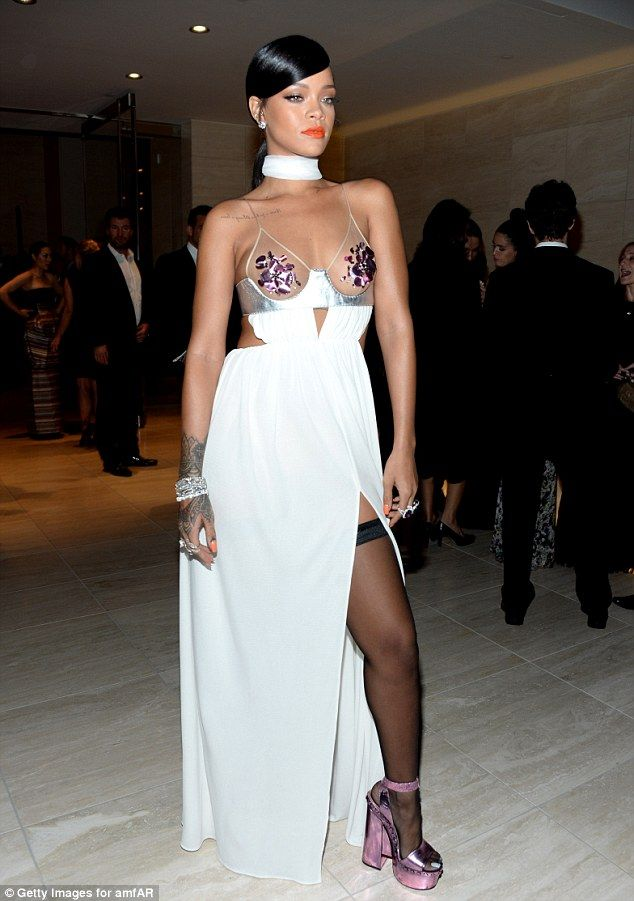 Rihanna Exposes Breasts and Legs at the 2014 amfAR Gala
