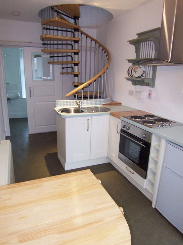 ONE of Scotland's smallest homes has gone on sale – and it's less than 7ft 6in wide.  The tiny house is on the market for offers over £55,000.  Inside the house in Cuminestown, Aberdeenshire, is a kitchen, shower room and an upstairs livingroom-bedroom – and that is just 20ft 5in long.  When its current owners bought the property, which has 28sqm of floor space, in 2009, the building – which is between two normal homes – was an office.