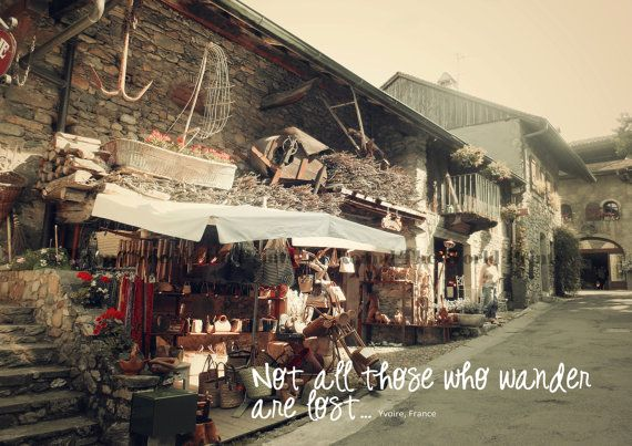 Not All Those Who Wander Are Lost - inspirational quote over dreamy photograph of Yvoire, France.