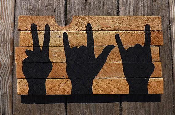 Peace Love Rock and Roll painting on reclaimed wood sign