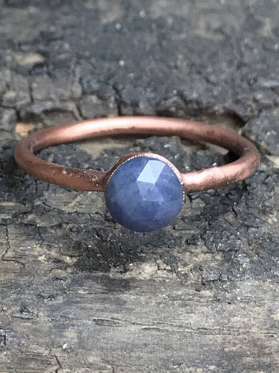 Find more Rough & Precious treasures: https://www.etsy.com/shop/ROUGHandPRECIOUS?ref=seller-platform-mcnav  Listing is for >one< sapphire copper ring.  Blue sapphire ring / September birthstone ring / rosecut gemstone ring / gemstone ring / Gift for her / Anniversary gift / Copper ring  One beautiful, rosecut sapphire, electroformed in copper on a solid copper band. The copper is patinated to a beautiful antique copper finish an...