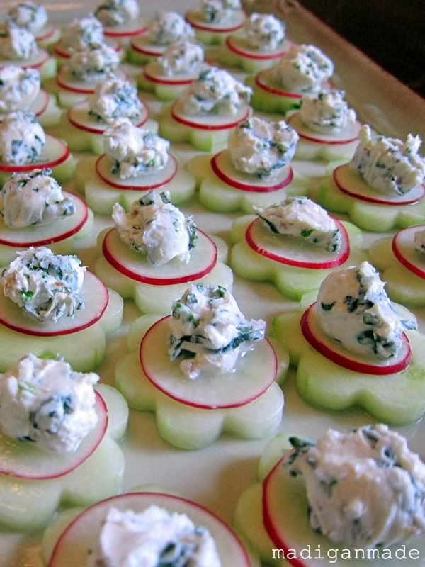"Garden Fresh Herbed Cucumber ""Flower"" Bites:    1 tsp lemon juice  1/2 tsp lemon zest  2 tbsp chopped pecans (optional)  2 tbsp mint, thinly sliced  2 tsp chopped chives  4 ounces, softened cream cheese  1/8 tsp salt  1 seedless cucumber, medium sliced into 32 rounds  3-4 medium radishes, sliced thinly into 32 rounds  kosher salt"