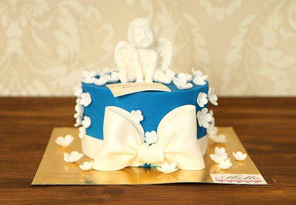 """Детский торт """"Ангелочек""""  #ТортСАнгелочком подойдет к празднику по любому поводу: День рождения, Свадьба, Крестины или #ДеньСвятогоВалентина. Пусть ангел хранит Вас! Вот, что говорит этот великолепный торт. Нежность ангелочка также светла, как ясные тёплые краски сахарной глазури торта, а нежные украшения в виде цветов – это #радость будущего.  С радостью изготовим, а если вы пожелаете то и доставим, #ТортАнгелочек весом от 2-х кг стоимостью 1950₽/кг.  Изготовление #ФигуркиИзМастики…"""