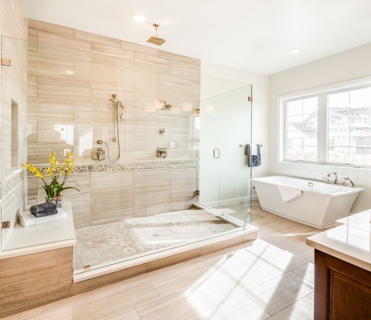 Oversized, walk-in shower in the master bathroom by D.R. Horton. Multiple shower heads including a waterfall shower head! #Colorado #FindYourHome