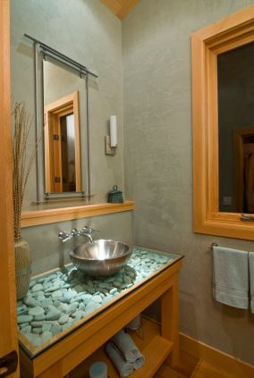 River rock craft ideas! You can even cover your bathroom counter with river rocks beneath a pane of glass.