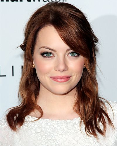 For her beachy half updo, #EmmaStone left her ends straight for a windswept effect. http://www.instyle.com/instyle/package/general/photos/0,,20574105_20576274_21129913,00.html