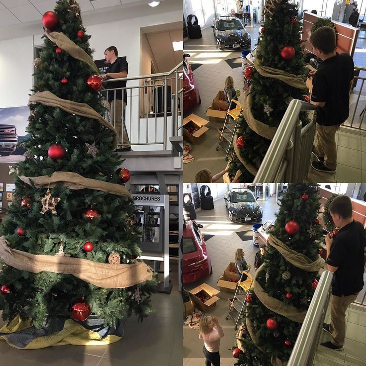 Jesse and Amy are being creative decorating our Tree at the dealership. 'Tis the start of the Season. #christmastree #christmastime #christmas #tistheseason #buick #gmc