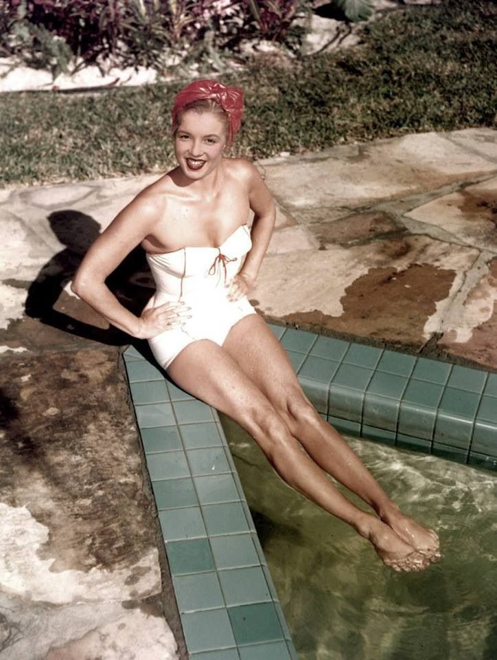This is a famous photo of Esther Williams. Marilyn's face has been placed on her body.