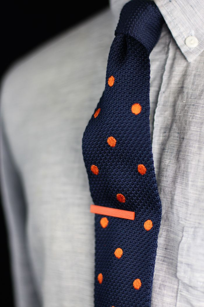 Fun polka dot knit tie in classic navy blue and bold tangerine orange. Via Bows-N-Ties - $18.90