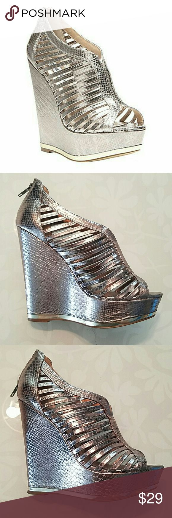 Steve Madden wresse silver cage bootie wedge 8 Beautiful Steve Madden caged wedges, better than new Sky High extremely comfortable, fast shipping - store closing soon - great color matches everything! Steve Madden Shoes