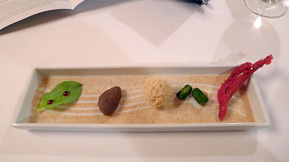 """The Sea Garden amuse-bouche, sets the table for the sort of invention to follow. Set in a bed of dried shrimp """"sand,"""" left to right: Oyster ..."""