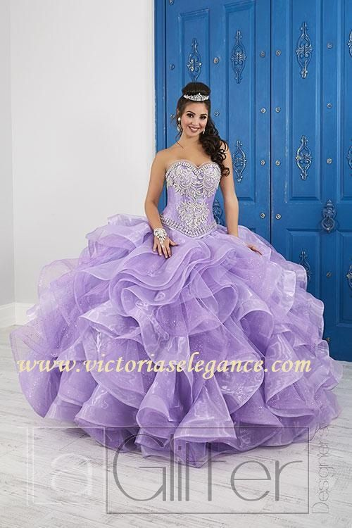8850e249d1a This gorgeous ball gown features sheer detail with crystal beading around  the sweetheart neckline. The bodice is accented with corset boning and  beaded lace ...