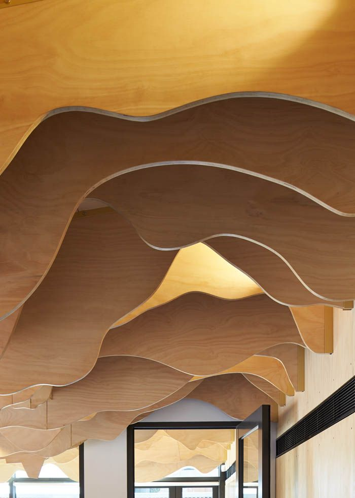 Detail of the plywood fins suspended over the Cubbyhouse in the Broadmeadows Children's Court | Cubbyhouse by Mihaly Slocombe (2014-15) | Broadmeadows, Victoria, Australia | Photo: Peter Bennetts