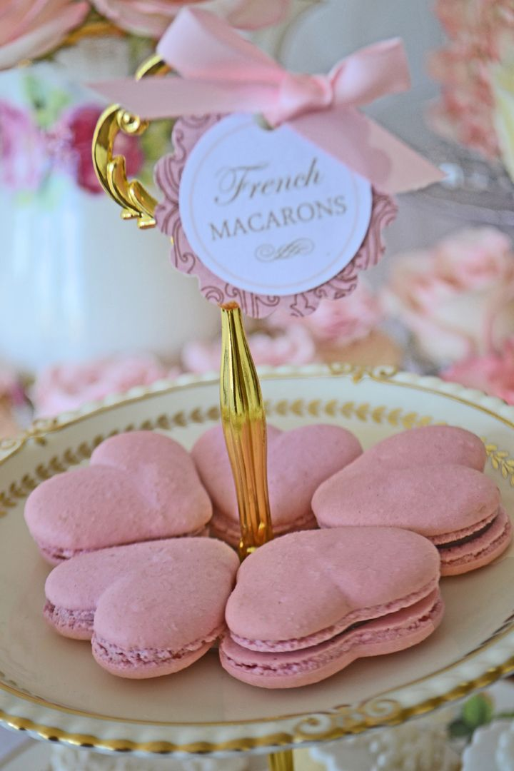 Heart shaped pink macarons for a vintage dessert table. Macarons from Bake Sale Toronto. China from Vintage Dish Rental.