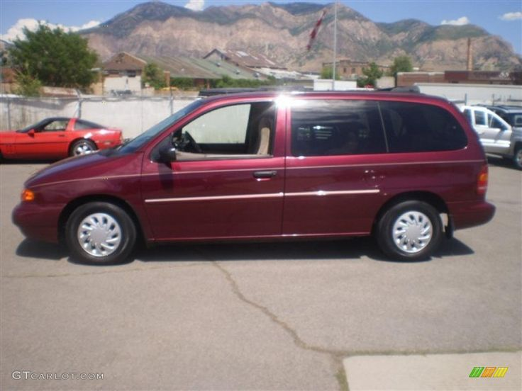 1998 Ford Windstar GL in the Cabernet red Metallic and 15'' steel wheels and hubcaps.