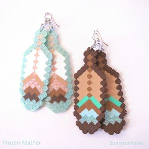 """These ultra-cool 8-Bit Feather Fantasy Earrings come to us from the colorful collective The Soft Museum. They feature feathers in neutral hues including pearl, copper, silver, tan, grey, black, white, and sparkling clear Hama beads. The earrings are available in various color options. They are 100% handmade using only premium Hama beads - small plastic beads that are fused together upon heating. The feathers measure 3.75"""", and hang 4.5"""" in total length from the ear."""