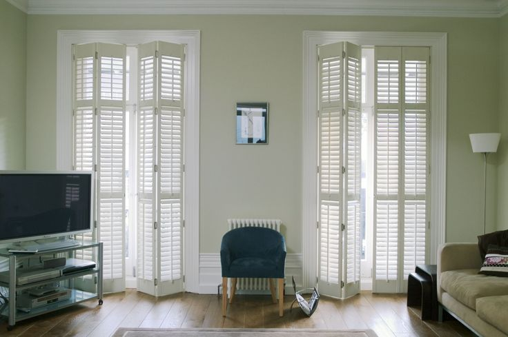 Full Height Lounge Shutters by Apollo Blinds. Modern window dressing. White home decor ideas. Neutrals. Contemporary inspiration for the living room.