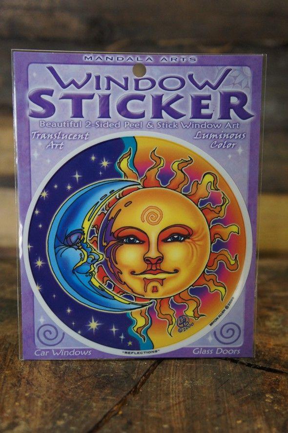 Raamsticker met een stralende zon en een maan