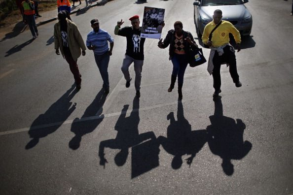 People dance as they take part in a march to commemorate Youth Day in Soweto Township on June 16 2013 in Johannesburg South Africa Youth Day...