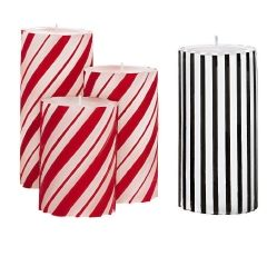 GloLite by PartyLite is has created Striped Pillar Candles available in black and vanilla...