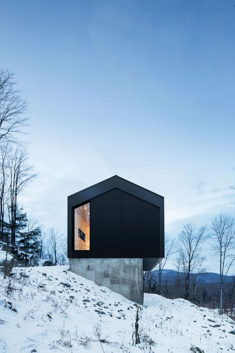 The project's unique challenges—a tight budget and steep, difficult terrain — led the architects to a creative solution that gave the house its delightfully sculptural appearance. Photo by Adrien Williams.