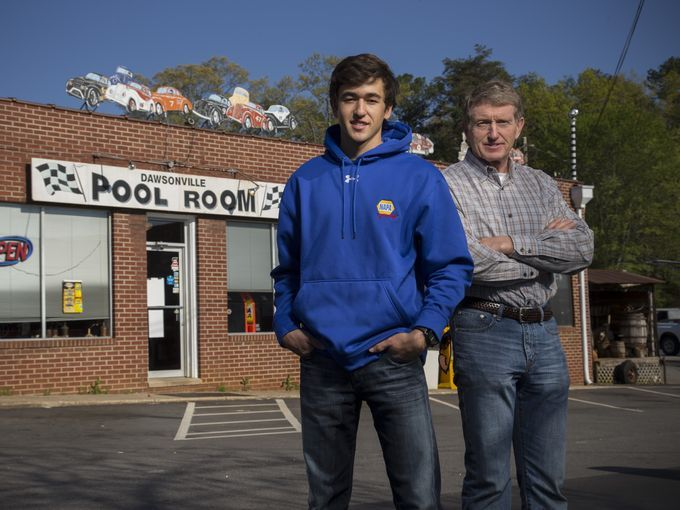 Chase Elliott, left, and his father Bill Elliott stand in front of the Dawsonville Pool Room. Bill Elliott is a former NASCAR Cup champion, ...