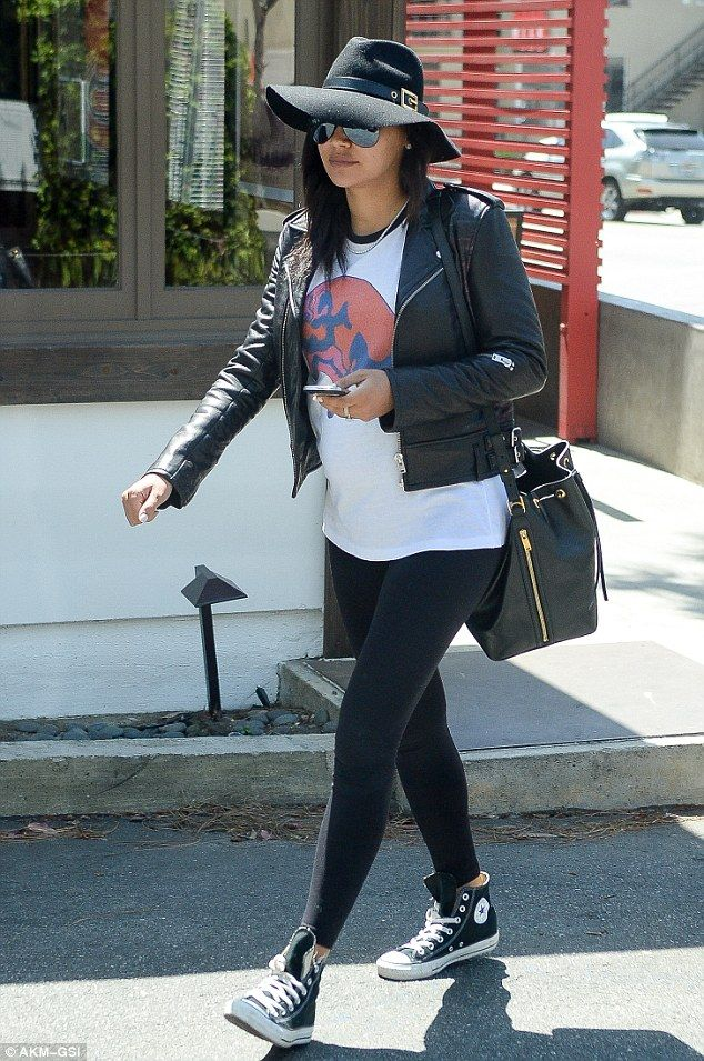 Off-duty style win: Naya Rivera covered her growing baby bump in a casual but stylish ense...