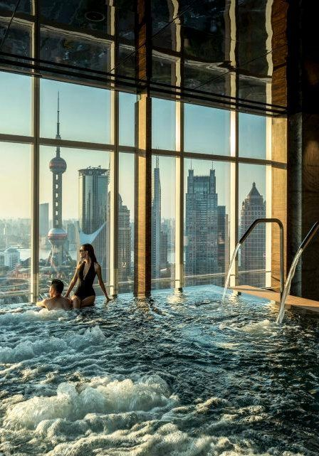 At @Four Seasons Hotel Pudong, Shanghai's FLARE spa, a soak for two comes with an electrifying city view.