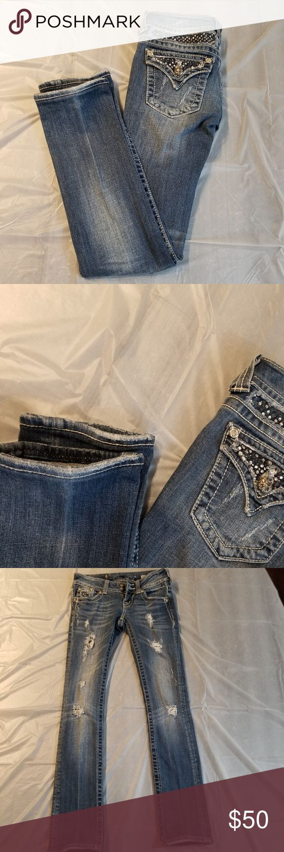 """Miss Me Skinny Jeans Size 23 Excellent preowned condition.  Lots of embellishments and distress denim.  I measured waist 13"""".  The inseam is 33. 98% cotton 2% elastane Miss Me Bottoms Jeans"""