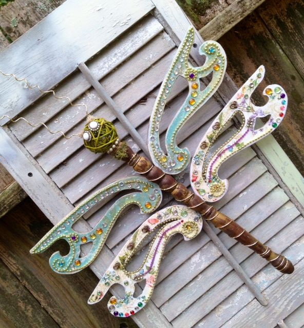 Dragonfly garden art.. Unique Dragonfly in your backyard. Dragonfly Decor Re-purposed ceiling fans and table legs makes this dragonfly unique. I like to use lots of bling, jewelry, and found objects on my dragonflies.