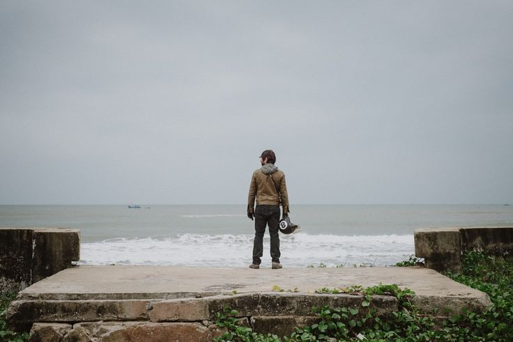 Portrait on the oceanside of Vietnam. A man and his helmet